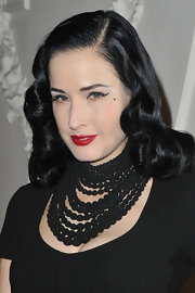 Dita Von Teese wore a thick layered necklace for the Jean Paul Gaultier Haute Couture show.