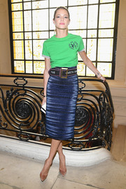 Helena Bordon dressed up her tee with a metallic blue pencil skirt by Mugler.