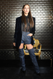 Irina Shayk sealed off her funky look with a pair of thigh-high denim boots by Jean Paul Gaultier Couture.
