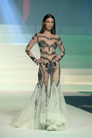 Bella Hadid left little to the imagination when she wore this sheer mint-green gown at the Jean Paul Gaultier Couture show.