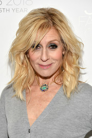 Judith Light glammed up a simple gray cardigan with a stunning opal pendant.
