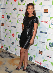 Alicia looked gorgeous in a liquid black dress with shimmering bronze stilettos.