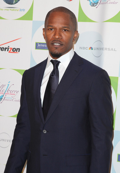 The actor hit the red carpet in a tailored navy suit with a white shirt and a satin tie.