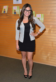 Jenna chose a classic black skirt to pair with a black top and gray cardigan.