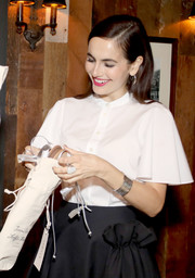 Camilla Belle visited the Jenni Kayne + Loeffler Randall Pop-Up in LA wearing a stylish silver cuff.