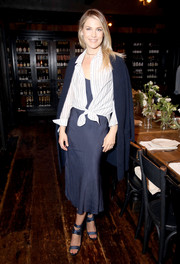 Ali Larter visited the Jenni Kayne + Loeffler Randall Pop-Up in LA wearing a striped shirt over a navy dress.