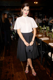 Camilla Belle capped off her ensemble with a fringed gray leather purse, also by Loeffler Randall.