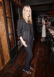 Molly Sims added a girly touch with a pair of strappy black sandals by Loeffler Randall.