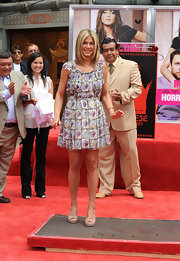 Jennifer attended her hand and footprint ceremony wearing a tiled floral frock. We love the new look on Jen!