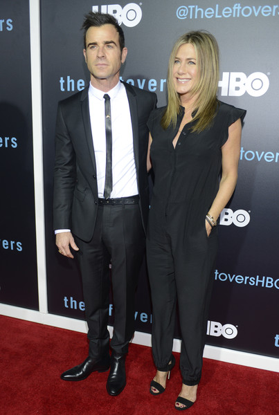 Jennifer Aniston Jumpsuit [season,the leftovers,suit,carpet,red carpet,tuxedo,event,formal wear,premiere,flooring,dress,white-collar worker,jennifer aniston,justin theroux,paramount theatre,austin,hbo,l,premiere,atx television festival]