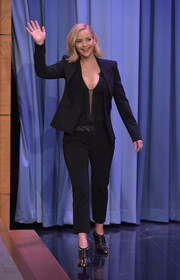 Jennifer Lawrence added major edge with a pair of studded black booties by Christian Louboutin.