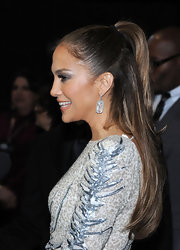 Jennifer Lopez wore her hair in a simple half up, half down style at the 2011 American Music Awards post party.