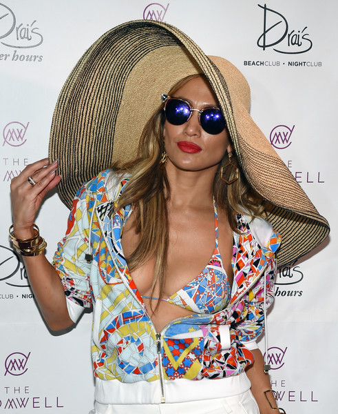 Jennifer Lopez Cateye Sunglasses [eyewear,clothing,sun hat,hat,headgear,lip,sunglasses,fashion accessory,sombrero,knit cap,jennifer lopez hosts carnival del sol,jennifer lopez,beach club - nightclub,the cromwell las vegas,nevada,drai,carnival del sol,pool party]