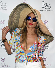 Jennifer Lopez looked totally summer-ready with her wide-brimmed straw hat while hosting the Carnival Del Sol pool party.