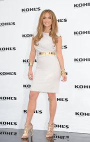 Jennifer Lopez donned strappy snakeskin sandals to the press conference of she and husband Marc Anthony's new Kohl line. She paired the sizzling heels with a white sheath dress and gold accessories.
