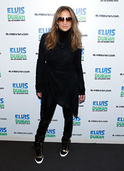 JLo kept her look hip and edgy with an asymmetrical wrap tunic that featured a high turtleneck.