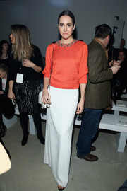Louise Roe brought a dazzling pop of color to the Jenny Packham fashion show with this bright coral sweater.