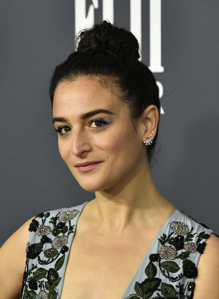 Jenny Slate Bright Eyeshadow [hair,face,hairstyle,eyebrow,beauty,chin,lip,bun,chignon,black hair,arrivals,jenny slate,critics choice awards,barker hangar,santa monica,california,jenny slate,critics choice movie awards,saturday night live,actor,stock photography,photograph,livingly media,beauty,celebrity]