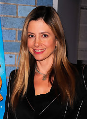 Mira Sorvino keeps her long locks straight and shiny. To get her look, flat-iron small sections of dry hair until smooth and then tousle ends with fingertips to create a casual effect.