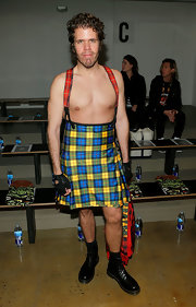 Perez Hilton made a bold fashion statement by wearing a colorful kilt and not much else at the Jeremy Scott Fall 2013 show.
