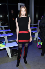 Larsen Thompson attended the Jeremy Scott fashion show wearing a black knit mini dress with red accents.