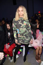 Jasmine Sanders kept it playful in a patched camo-print sweater dress by Jeremy Scott during the brand's Fall 2018 show.