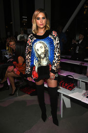 Ashley Benson cut a striking figure in this Jeremy Scott funnel-neck sweater that featured an eclectic mix of Jesus Christ, floral, and leopard prints!