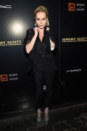 Taryn Manning layered a shiny black blazer over a matching vest for the 'Jeremy Scott: The People's Designer' after-party.