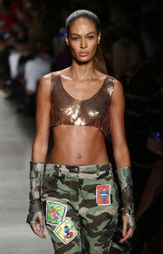 Joan Smalls rocked fingerless camo gloves and matching pants at the Jeremy Scott runway show.