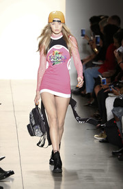 Gigi Hadid looked funky in a body-con mini dress with mesh sleeves at the Jeremy Scott runway show.