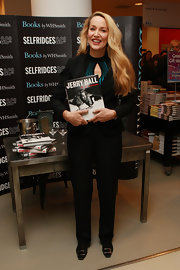 Jerry Hall wore buckle embellished flats to her Selfridges book signing. She paired the shoes with a black suit and cutout top.