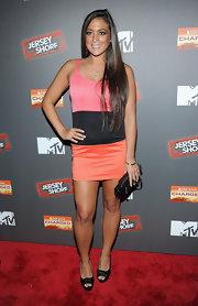 Sammi Giancola paired black peep-toe pumps with her eye-popping color-blocked dress.