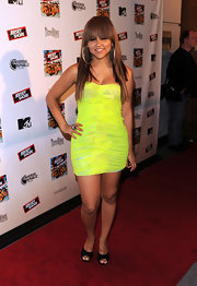 Kat showed off her red carpet style in a neon strapless dress.