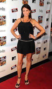 Danielle Staub showed off her toned figure in a black day dress.