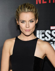Rachael Taylor wore her hair pulled back in a messy updo to highlight her face.