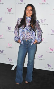 "Emmanuelle went for a 70's vibe in a pair of ""Bette"" high-rise wide leg jeans and a sheer floral blouse."