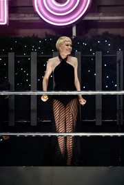 Jessie J flashed plenty of leg in a black halter dress with a see-through skirt as she performed during the Selfridges Christmas lights switch-on event.