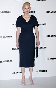 Tilda Swinton looked sophisticated in a navy in a crisp blue cocktail dress for the Jil Sander fashion show.