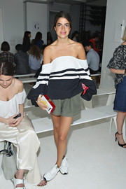 For a bit of color to her neutral outfit, Leandra Medine accessorized with a red and white box clutch.