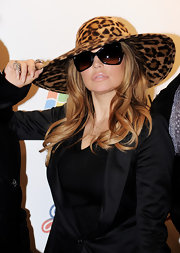 Fergie made a glamorous appearance at the Jingle Bell Ball in a bold leopard hat and butterfly sunglasses. She amped up her look with bold talons in a soft nude hue.