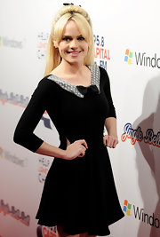 Duffy wears a little black dress with a white peter pan collar and darling neckline bow.