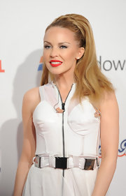 Pop star Kylie Minogue showed off sultry red lips while attending the Jingle Bell Ball. She completed her bold pout with a swipe of black liner on her upper lids.