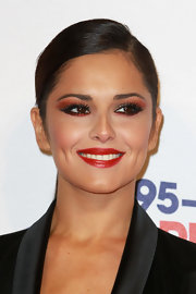 Cheryl played up the ruby tones of eyeshadow with a bright red lip.