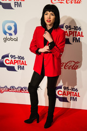 Carly Rae Jepsen was androgynous-chic in a red blazer layered over a black shirt at the Jingle Bell Ball.
