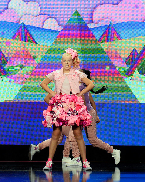 JoJo Siwa Vest [performance,fashion,fashion show,event,performing arts,public event,talent show,stage,fashion design,fun,singer,jojo siwa,nickelodeon presentation at licensing expo 2017,dancer,social media influencer,fashion,four seasons hotel las vegas,presentation,fashion show,event]