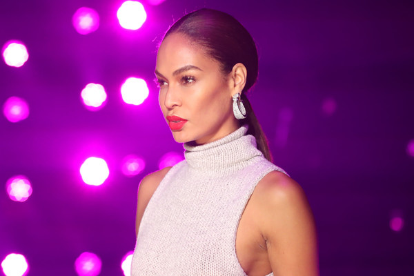 Joan Smalls Ponytail [violet,beauty,fashion,light,purple,performance,pink,skin,lip,forehead,joan smalls,brandon maxwell - runway,runway,brandon maxwell fall winter 2018 collection,new york city,appel room,new york fashion week]
