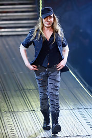 John Galliano paired his ripped jeans with a black vest and lace-up boots.