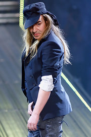 John walked the runway at his Fashion Show donning a military cap.