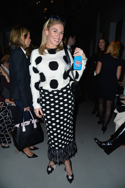 Hofit Golan attended the John Galliano runway show in black and white polka dots and fringe.