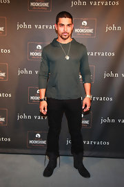 Wilmer Valderrama attended the John Varvatos anniversary party wearing a forest green hoodie.